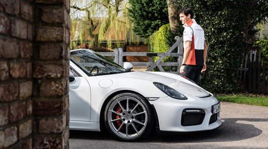 Mark Webber and a pair of Porsche Spyders
